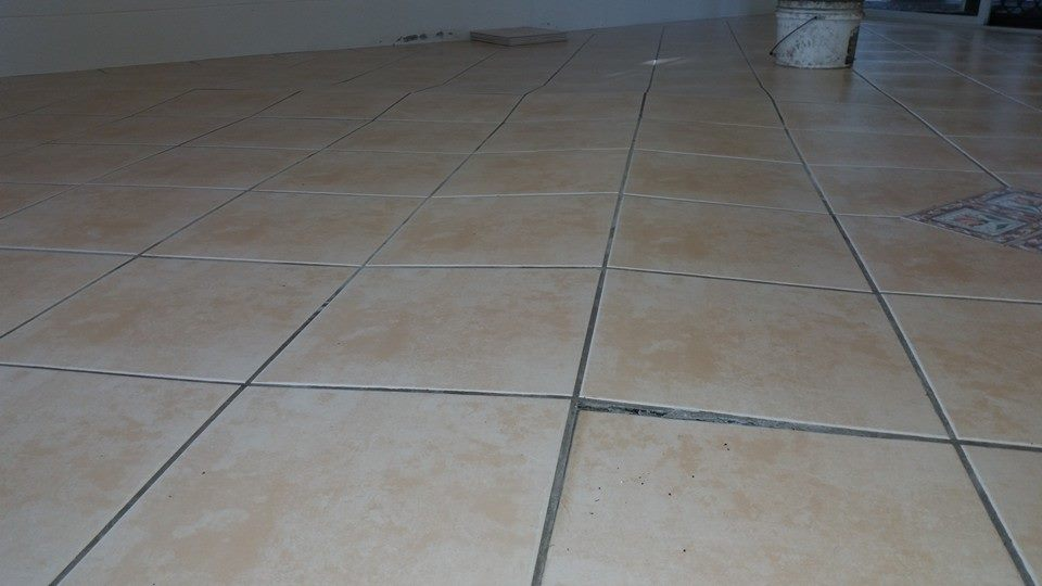 slightly lifted tiles in need of repair