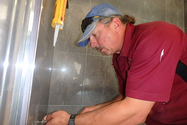 man working with tiles