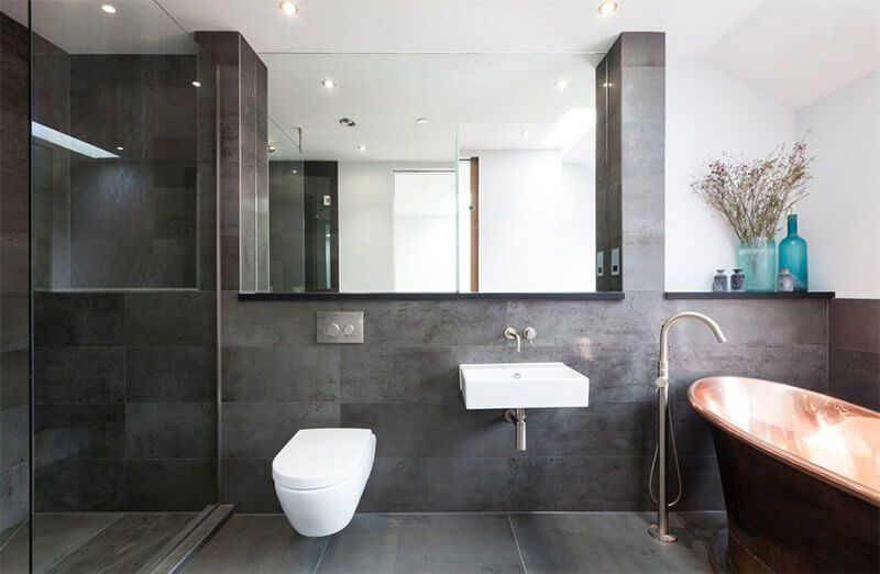 grey walled bathroom with bathtube