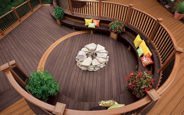 a stylish deck with a curved wooden seat