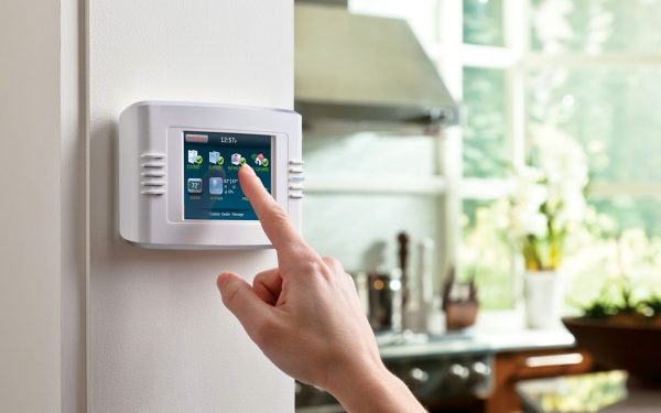 a person operating a smart home device