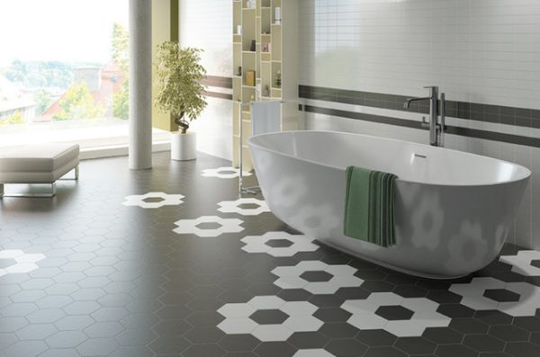 a modern bathroom with a simple white bath tub