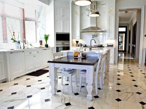 an industrial kitchen with black and white floor tiles