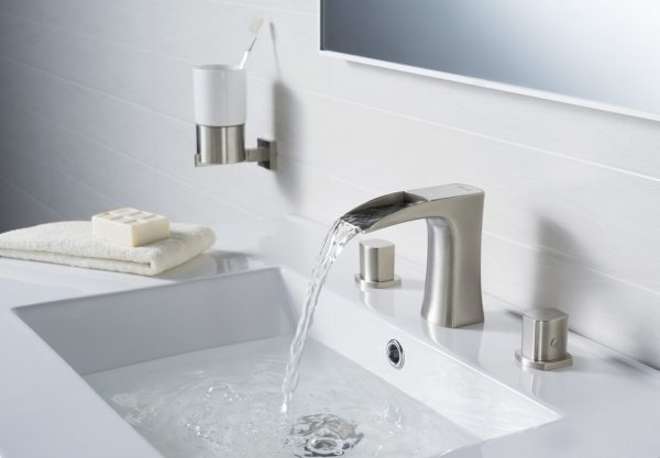 water pouring from a modern faucet